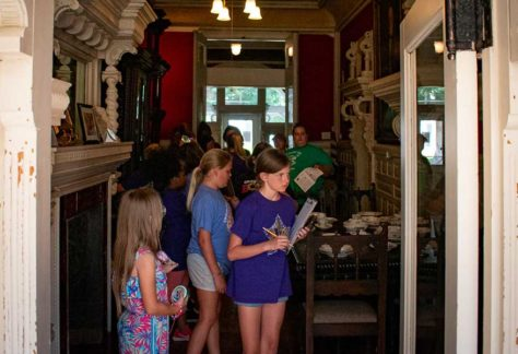 Young visitors enjoying an interactive scavenger hunt while on tour