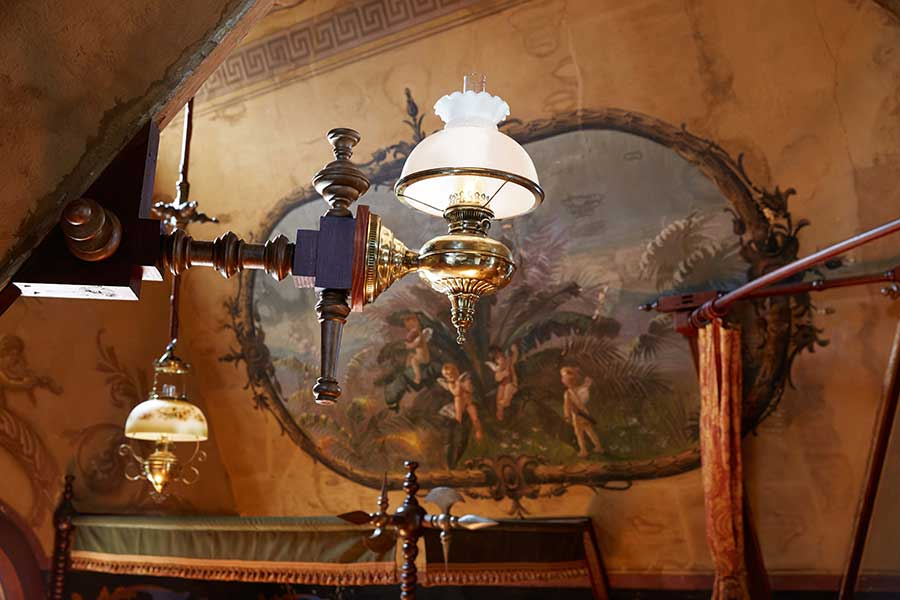 Original lamps and mural in Cupid's Park Theatre